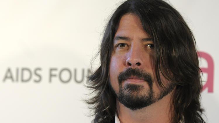 FILE - In this Feb. 24, 2013 file photo, musician Dave Grohl arrives at the 2013 Elton John Oscar Party in West Hollywood, Calif. Grohl will be among the top performers at the South By Southwest music festival in Austin, Texas, starting Tuesday, March 12, 2013. (Dan Steinberg/Invision/AP, File)