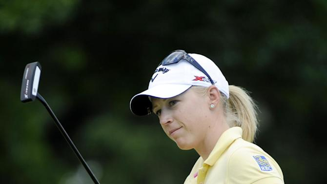 Morgan Pressel reacts to shot on the 18th hole during the third round of the LPGA Championship golf tournament at Locust Hill Country Club in Pittsford, N.Y., Sunday June 9, 2013. (AP Photo/Gary Wiepert)