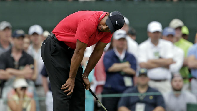 Tiger Woods reacts after missing a birdie putt on the first hole during the fourth round of the Masters golf tournament Sunday, April 14, 2013, in Augusta, Ga. (AP Photo/Charlie Riedel)