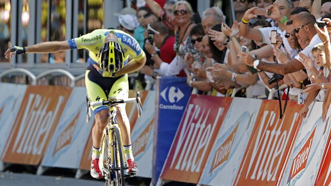 Australia's Michael Rogers bows for cheering spectators as he crosses the finish line to win the sixteenth stage of the Tour de France cycling race over 237.5 kilometers (147.6 miles) with start in Carcassonne and finish in Bagneres-de-Luchon, France, Tuesday, July 22, 2014. (AP Photo/Peter Dejong)