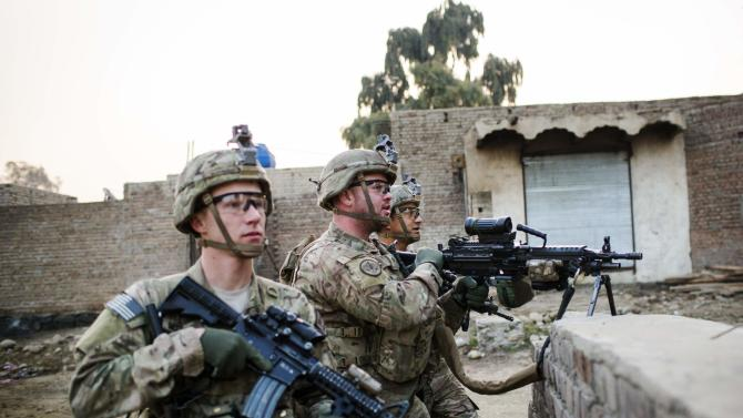 U.S. soldiers from Grim Company of the 3rd Cavalry Regiment stand guard near an Afghan police checkpoint near Forward Operating Base Fenty in the Nangarhar province of Afghanistan