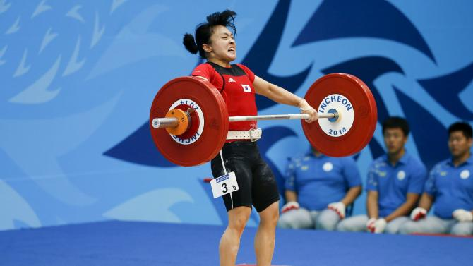 South Korea's Im Jyoung-hwa competes in the women's 48kg snatch weightlifting competition at the Moonlight Festival Garden during the 17th Asian Games in Incheon