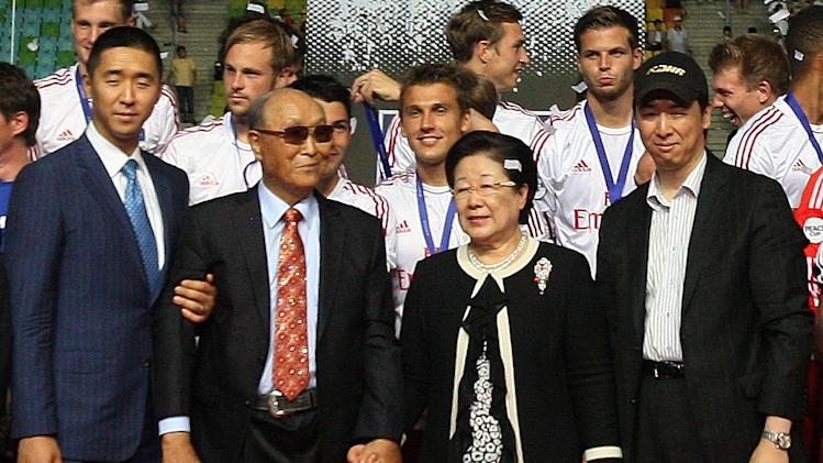 In this July 22, 2012 photo, the Rev. Sun Myung Moon, the founder of the Unification Church, second from left, poses with his wife Hak Ja Han Moon, second from right, his sons Hyung-jin Moon, left, and Kook Jin Moon during the closing ceremony of the 2012 Peace Cup Suwon at Suwon World Cup Stadium in Suwon, South Korea. Moon, the self-proclaimed messiah who founded the church, died Monday, Sept. 3, 2012, at a church-owned hospital near his home in Gapyeong County, northeast of Seoul, church officials said. He was 92. (AP Photo/Ahn Young-joon)