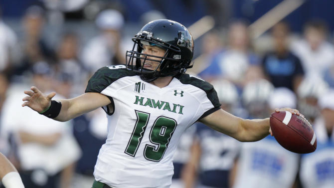 Hawaii quarterback Sean Schroeder throws a pass during the first quarter of an NCAA college football game against Brigham Young on Friday, Sept. 28, 2012, in Provo, Utah.  (AP Photo/Rick Bowmer)