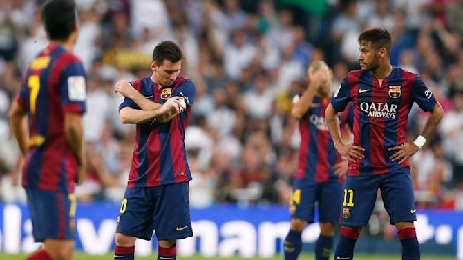 """Barcelona's Messi and Neymar react during their Spanish first division """"Clasico"""" soccer match against Real Madrid at the Santiago Bernabeu stadium in Madrid"""