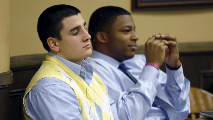 Trent Mays, 17, left, and co-defendant 16-year-old Ma'lik Richmond sit at the defense table during a recess  of their trial on rape charges in juvenile court on Thursday, March 14, 2013, in Steubenville, Ohio. Mays and Richmond are accused of raping a 16-year-old West Virginia girl in August of 2012. (AP Photo/Keith Srakocic, Pool)