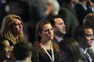 Supporters of US Republican presidential candidate Mitt Romney watch results on television in Boston at Romney's election night event. President Barack Obama took two big strides towards re-election Tuesday by blocking Romney's grab for Pennsylvania and Wisconsin, the first key states called in their bitter White House race