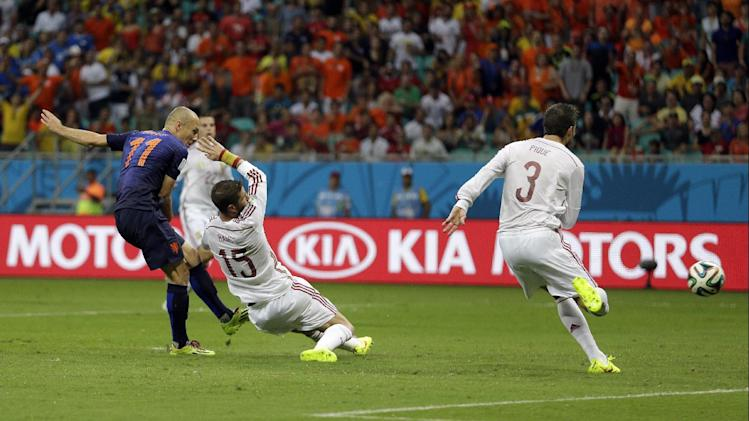 In this June 13, 2014 file photo, Netherlands' Arjen Robben kicks past Spain's Sergio Ramos (15) and Gerard Pique to score his side's second goal during the second half of the group B World Cup soccer match at the Arena Ponte Nova in Salvador, Brazil. Robben had already scored one goal in the rout over Spain, but his second was done with awe-inspiring speed