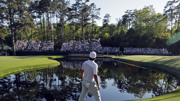 Jason Day, of Australia, looks for his ball on the 15th green during the third round of the Masters golf tournament Saturday, April 13, 2013, in Augusta, Ga. (AP Photo/Charlie Riedel)
