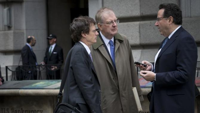 Lawyers for General Motors Richard Godfrey and Arthur Steinberg arrive at the US District Bankruptcy Court in lower Manhattan section of New York