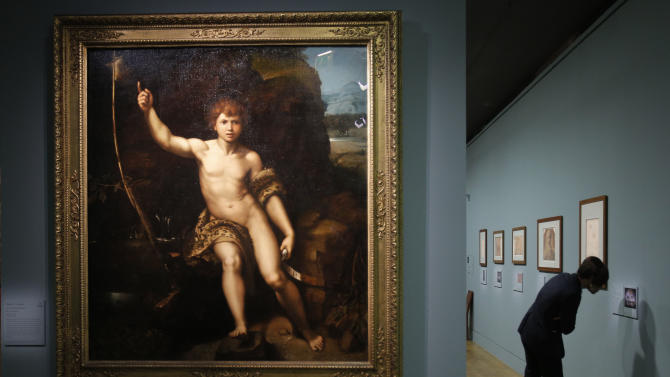 """Saint Jean Baptiste dans le desert"", a painting by Raphael is presented as part of the exhibition ""Late Raphael"" at the Louvre museum, in Paris, Tuesday, Oct. 9, 2012. This exhibition, organized by the Louvre from Oct. 11 to Jan. 14, 2013 in partnership with the Prado Museum, brings together the works produced by Raphael in Rome during the last years of his life. (AP Photo/Christophe Ena)"
