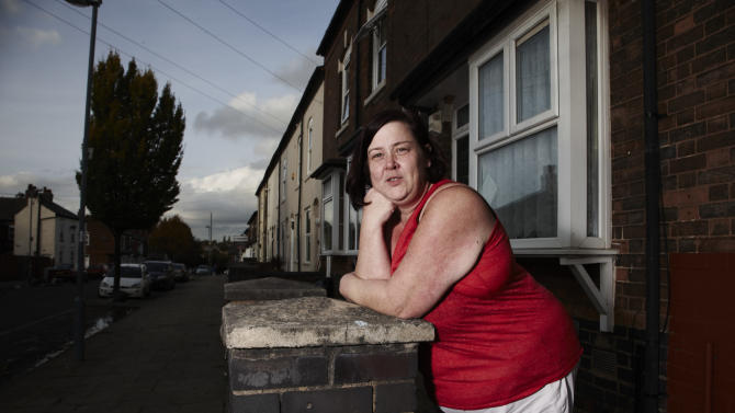 "In this photo provided by Channel 4 on Tuesday, Jan. 21, 2013, 'White Dee' featured in the show Benefits Street, poses for a promotional still. The stars of Britain's most talked-about television show have a dubious claim to fame: They don't work. A shoplifter running away from police, a recovering drug addict and a ragtag band of jobless people are the unlikely stars of ""Benefits Street,"" a hit documentary-style program about welfare receipients that has drawn millions of viewers and stirred up a furious storm of complaints and controversy in Britain. Critics say the show _ which zooms in on the residents of a Birmingham street where 9 out of 10 people are said to live off state payouts _ is designed to fan hatred by showing people on the dole in the worst possible light. Scores of viewers took to Twitter to vent abuse at the residents as soon as the first episode aired earlier this month, and some even made death threats. (AP Photo/Channel 4, Richard Ansett)"