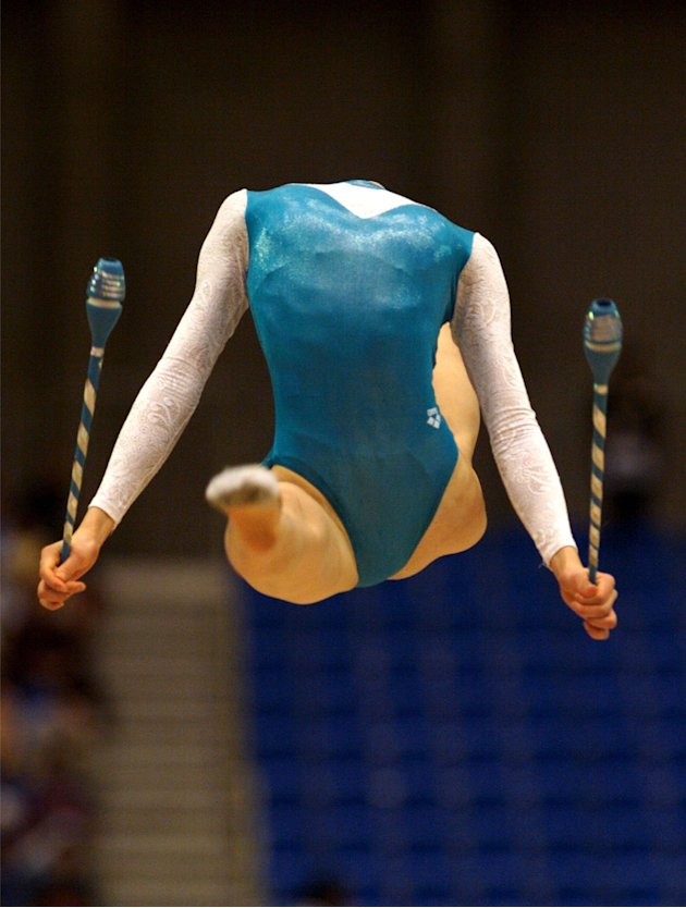 GOLD MEDALIST ZHOU XIAOJIING OF CHINA PERFORMS HER CLUBS ROUTINE.