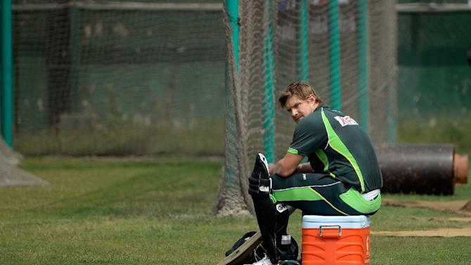 Australian all-rounder Shane Watson watches teammates during a practice session at the Sher-e-Bangla National Cricket Stadium in Dhaka, on March 22, 2014