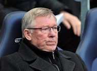 Manchester United manager Alex Ferguson watches his team play against Manchester City during their English Premier League match at The Etihad Stadium in Manchester. City seized control of the Premier League title race after Vincent Kompany's first-half header powered them to a 1-0 win over bitter rivals United