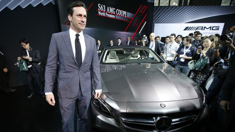 Jon Hamm poses for photographers next to Mercedes-Benz S63 AMG Coupe at New York International Auto Show in New York City