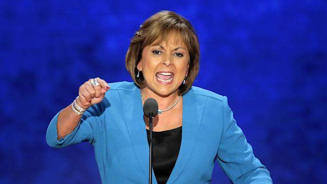 FILE - In this Aug. 29, 2012, file photo, New Mexico Governor Susana Martinez addresses the Republican National Convention in Tampa, Fla. A political generation ago, the West signaled the nation's rightward swing -- from the emergence of Ronald Reagan to the success of tax limitation ballot measures in California and Colorado. But now the fabled expanse of jagged peaks, arid deserts and emerald coastlines is trending in a different direction. From Washington state -- where voters in November legalized marijuana and upheld the legality of gay marriage -- to New Mexico, once a hotly-contested swing state that Republicans ceded to Democrats in the presidential campaign, the west has become solidly Democratic terrain. The coastal base states of Washington, Oregon and California continue to move further to left, while the hotly-contested swing states east of the Sierra Nevada are trending more and more toward the Democrats. (AP Photo/J. Scott Applewhite)