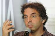 Israeli writer Etgar Keret speaks during a press conference one day ahead of the official opening of one of the worlds narrowest houses, in Warsaw, Poland, Friday, Oct. 19, 2012. The two-level Kerets House is no wider than 122 centimeters (48.03 inches) and was fitted into tiny space puzzlingly left between a pre-war house and a modern apartment block of the 1960s in downtown Warsaw. It is named after Etgar Keret, an Israeli writer of Polish roots who will be the first inhabitant of this artistic project of aluminum and polycarbonate. (AP Photo/Alik Keplicz)
