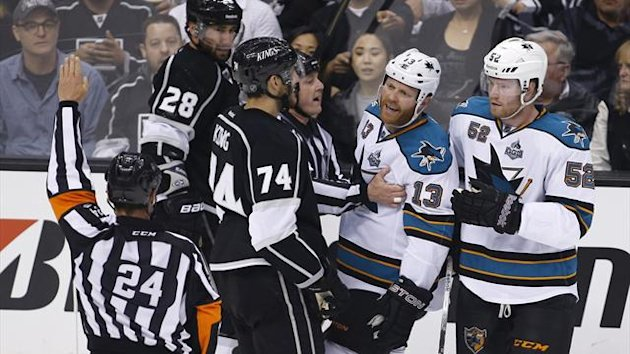 San Jose Sharks left wing Raffi Torres (13) reacts as he is called for a charging penalty after hitting Los Angeles Kings center Jarret Stoll (28) to the ice in the second period during Game 1 of their NHL Western Conference semifinal playoff hockey game