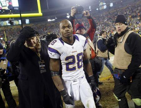 Minnesota Vikings Adrian Peterson leaves the field after a season-ending loss to the Green Bay Packers following their NFL NFC wildcard playoff football game in Green Bay
