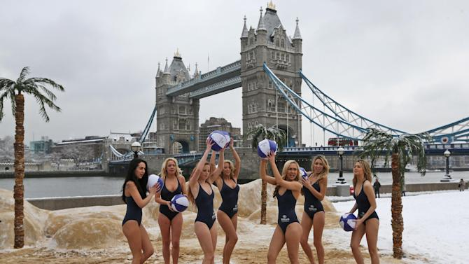 Backdropped by the iconic Tower Bridge, models is swimsuits play as they pose for the photographers on a pop-up 'beach' amid the snow, during a photo-opportunity to promote a hotel chain, by the river Thames in London, Monday, Jan. 21, 2013. Hundreds of fights were canceled in Britain, France and Germany Monday as snow and ice blanketed Western Europe.London's Heathrow airport canceled about 130 flights, 10 percent of the daily total, compared to 20 percent on Sunday.(AP Photo/Lefteris Pitarakis)