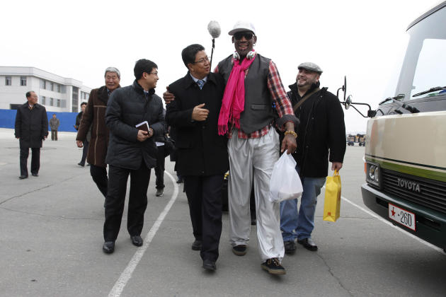 AP10ThingsToSee - Former NBA basketball star Dennis Rodman, second right, walks with North Korea's Sports Ministry Vice Minister Son Kwang Ho, third right, upon his arrival at the international ai