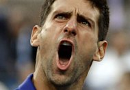 Novak Djokovic of Serbia reacts on court against Andy Murray of Great Britain during their 2012 US Open men's singles finals match at the USTA Billie Jean King National Tennis Center in New York