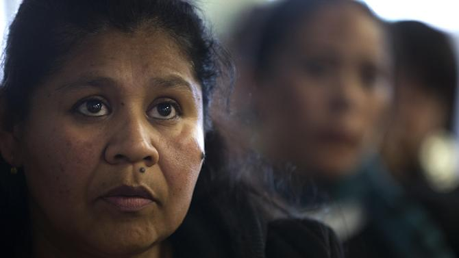 """Adelfina Guzman listens along with immigration advocates to President Barack Obama's speech on immigration reform, Tuesday, Jan. 29, 2013, in San Diego. The President on Tuesday praised bipartisan efforts to overhaul the nation's immigration laws, welcoming """"a genuine desire"""" to tackle a famously snarled system that has been stalled for almost two decades. (AP Photo/Gregory Bull)"""