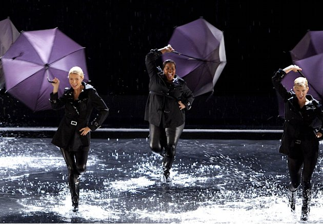"Holly (guest star Gwyneth Paltrow, C) performs ""Singing in the Rain"" and ""Umbrella"" with New Directions in ""The Substitute"" episode of ""Glee."""