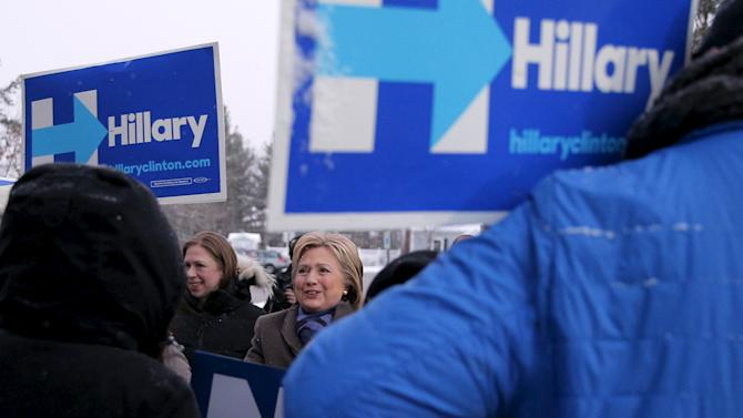 U.S. Democratic presidential candidate Hillary Clinton and her daughter Chelsea visit a polling place in Manchester