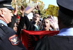 Demonstrators protest against the potential dismantling of Syrian chemical weapons in Albania in front of the Parliament in Tirana