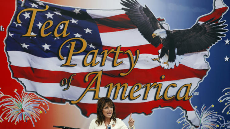 Former Alaska Gov. Sarah Palin speaks to Tea Party members during the Restoring America event, Saturday, Sept. 3, 2011, in Indianola, Iowa. (AP Photo/Charlie Neibergall)