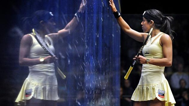 Nicol David of Malaysia is reflected in the glass during the women's final against Laura Massaro of England at the Australian Open squash tournament (AFP)