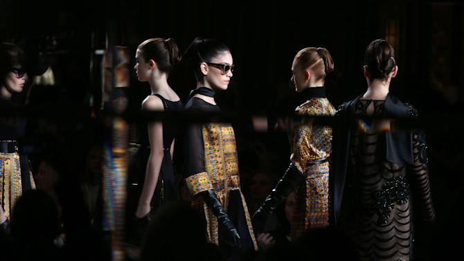 Models wear a design created by Temperley during London Fashion Week, at the Dorchester Hotel in central London, Sunday, Feb. 17, 2013. (Photo by Joel Ryan/Invision/AP)