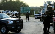 Mexican Federal police guard a crime scene near Reynosa on May 13, 2012. More than 20,000 people have disappeared in Mexico over the past six years of a brutal crackdown on drugs during the government of former president Felipe Calderon, a civic group said.
