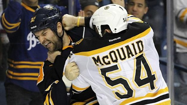 Buffalo Sabres defenseman John Scott (32) and Boston Bruins defenseman Adam McQuaid (54) fight (Reuters)