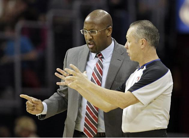 Cleveland Cavaliers coach Mike Brown, left, talks with referee Tony Brown during the first quarter of an NBA basketball game between the Milwaukee Bucks and the Cavaliers on Friday, Dec. 20, 2013, in