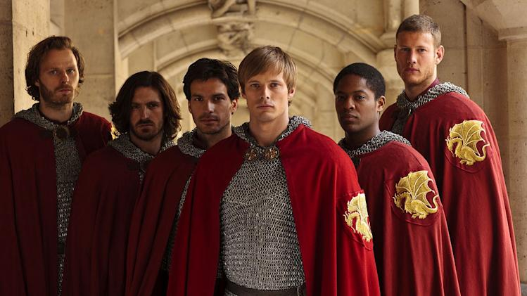 "Bradley James (center) stars as Prince Arthur joined by The Knights of the Round Table in ""Merlin."""