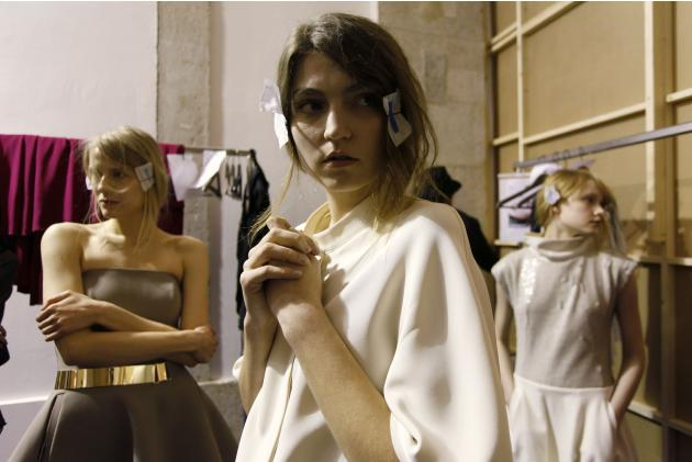 Models wait backstage before a presentation by fashion designer Lukasz Jemiol for the Fall/Winter 2014/15 collection during Lisbon Fashion Week