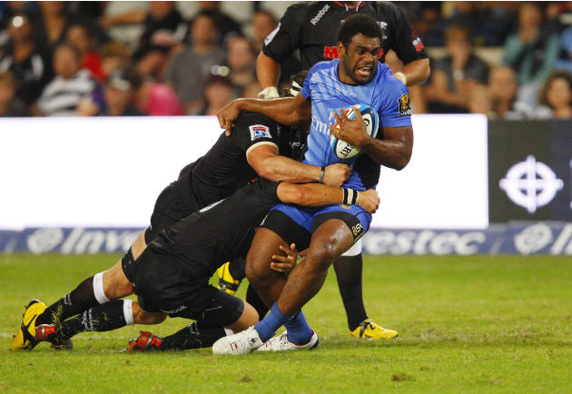 Western Force's Napolioni Nalaga is held in a tackle during the Super 15 Rugby Union match between Western Force of Australia and Coastal Sharks from Durban at the Kings Park in Durban on May 12, 2012