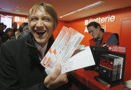 Michael Evanno, 31, shows the tickets he bought for the Rolling Stones concert at Virgin Megastore in Paris, Thursday Oct. 25, 2012. The Rolling Stones announced a surprise &quot;warm-up gig&quot; in Paris, and within an hour the Champs Elysees was swarming with fans hoping to get satisfaction with one of the 350 tickets for the Thursday night show. (AP Photo/Francois Mori)