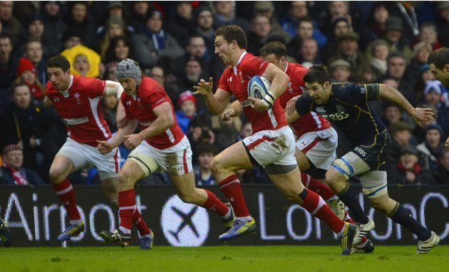 Wales' North is chased by Scotland's Beattie during their Six Nations rugby union match in Edinburgh
