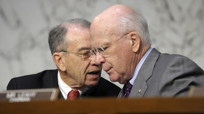 FILE - In this Feb. 13, 2013 file photo, Senate Judiciary Committee Chairman Sen. Patrick Leahy, D-Vt., right, talks with the committee's ranking Republican Sen. Charles Grassley, R-Iowa, on Capitol Hill in Washington. Tuesday March 12, 2013 meeting comes five days after the panel approved Congress' first gun control measure since December's carnage at a Newtown, Conn., elementary school that left 26 students and educators dead. That bill, by the Judiciary Committee's chairman, Sen. Patrick Leahy, D-Vt., and others, establishes long prison terms for illegal gun traffickers and straw purchasers, people who buy a firearm for criminals or others forbidden to buy one. (AP Photo/Susan Walsh, File)