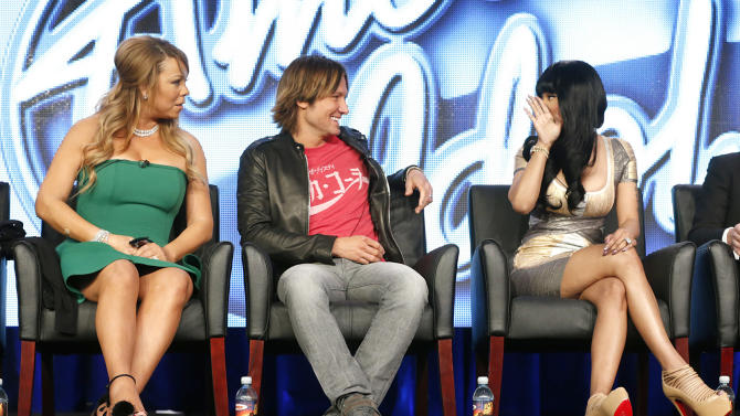 """Mariah Carey, Keith Urban and Nicki Minaj from """"American Idol"""" attend the Fox Winter TCA Tour at the Langham Huntington Hotel on Tuesday, Jan. 8, 2013, in Pasadena, Calif. (Photo by Todd Williamson/Invision/AP)"""