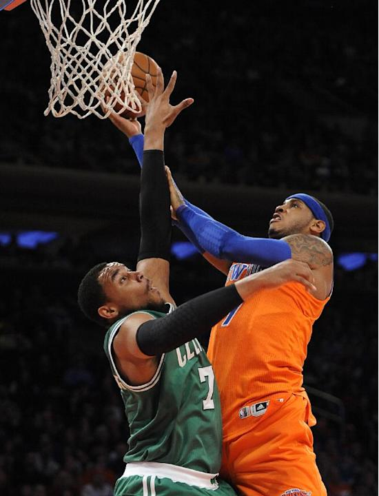 Boston Celtics' Jared Sullinger (7) blocks the shot of New York Knicks' Carmelo Anthony (7) during the first half an NBA basketball game on Sunday, Dec. 8, 2013, in New York