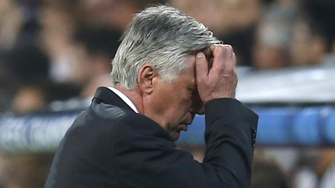 FILE - In this April 22, 2015, file photo, Real Madrid's coach Carlo Ancelotti walks to the dugout during the second leg quarterfinal Champions League soccer match between Real Madrid and Atletico Madrid at Santiago Bernabeu stadium in Madrid, Spain. Real Madrid has fired coach Carlo Ancelotti, one season after he led the club to its 10th European Cup title. Club president Florentino Perez said Monday, May 25, 2015,  that Ancelotti's successor would be announced next week. (AP Photo/Paul White, File)
