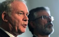 Northern Ireland's Deputy First Minister Martin McGuinness (left) speaks to the media, along with Sinn Fein party president Gerry Adams. Northern Ireland's Deputy First Minister McGuinness has been officially confirmed as his party's candidate for next month's Irish presidential election
