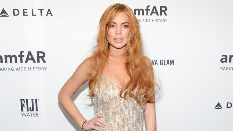 "FILE - This Feb. 6, 2013 file photo shows actress Lindsay Lohan attending amfAR's New York gala at Cipriani Wall Street in New York. Lohan will be a guest on ""Late Show with David Letterman"" next week. CBS says she will pay Dave a visit on the April 9 telecast. It will be her first ""Late Show"" appearance in six years. Lohan is promoting her guest appearance on the FX sitcom ""Anger Management,"" which will air two days later. On that episode, she will be playing herself but as a therapy patient of series star Charlie Sheen. (Photo by Evan Agostini/Invision/AP, file)"