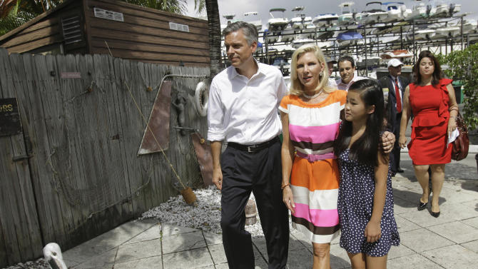 Republican presidential candidate, former Utah Gov. Jon Huntsman Jr., left, arrives for a campaign event in Miami, Wednesday, Aug. 10, 2011, with his wife Mary Kaye, center, and daughter Grace, 10.  Huntsman was endorsed by Jeb Bush Jr. at the event. (AP Photo/Lynne Sladky)