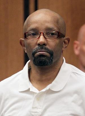 Anthony Sowell , the man charged with killing 11 women and dumping their remains around his Cleveland property and home, appears in Common Pleas Court as jury selection proceeds in his trial in Cleveland on Monday, June 6, 2011. (AP Photo/Marvin Fong, Pool)